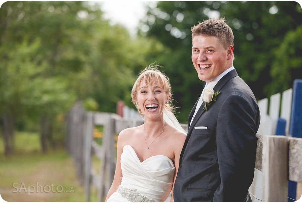 54-fence-couple-laughing-wedding